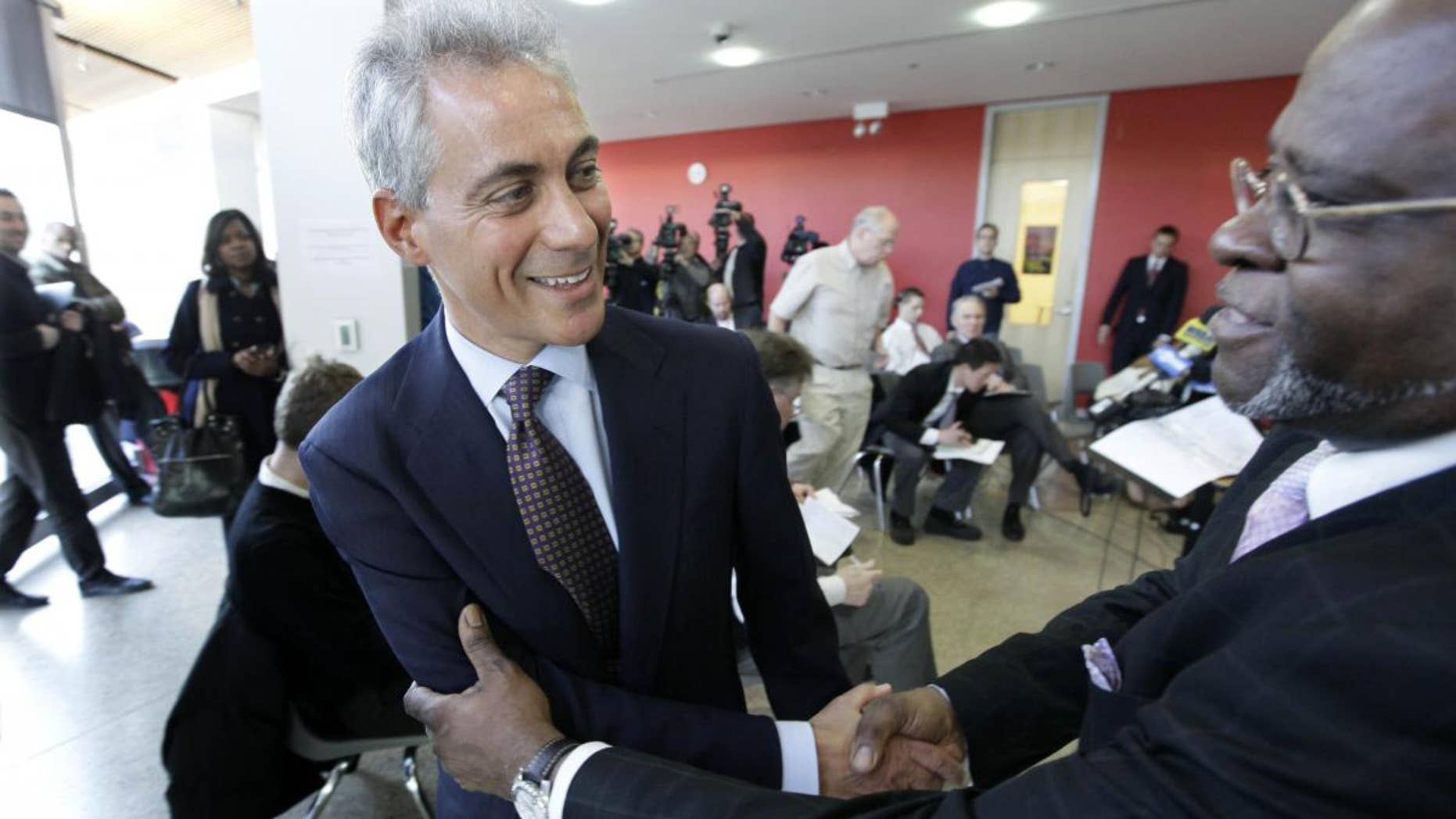 Chicago mayoral candidate Rahm Emanuel shakes hands after speaking at a news conference at the Better Boys Foundation, Tuesday, Jan. 4, 2011, in Chicago. (AP Photo/M. Spencer Green)