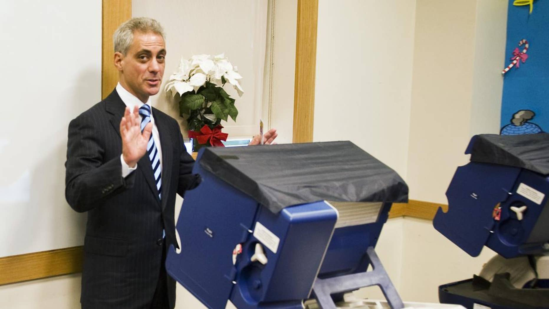 Chicago mayoral candidate Rahm Emanuel casts his ballot Monday, Jan. 31, 2011, at a Chicago public library on the first day of early voting for the Feb. 22, 2011 mayoral election. (AP Photo/Chicago Sun-Times, Rich Hein)