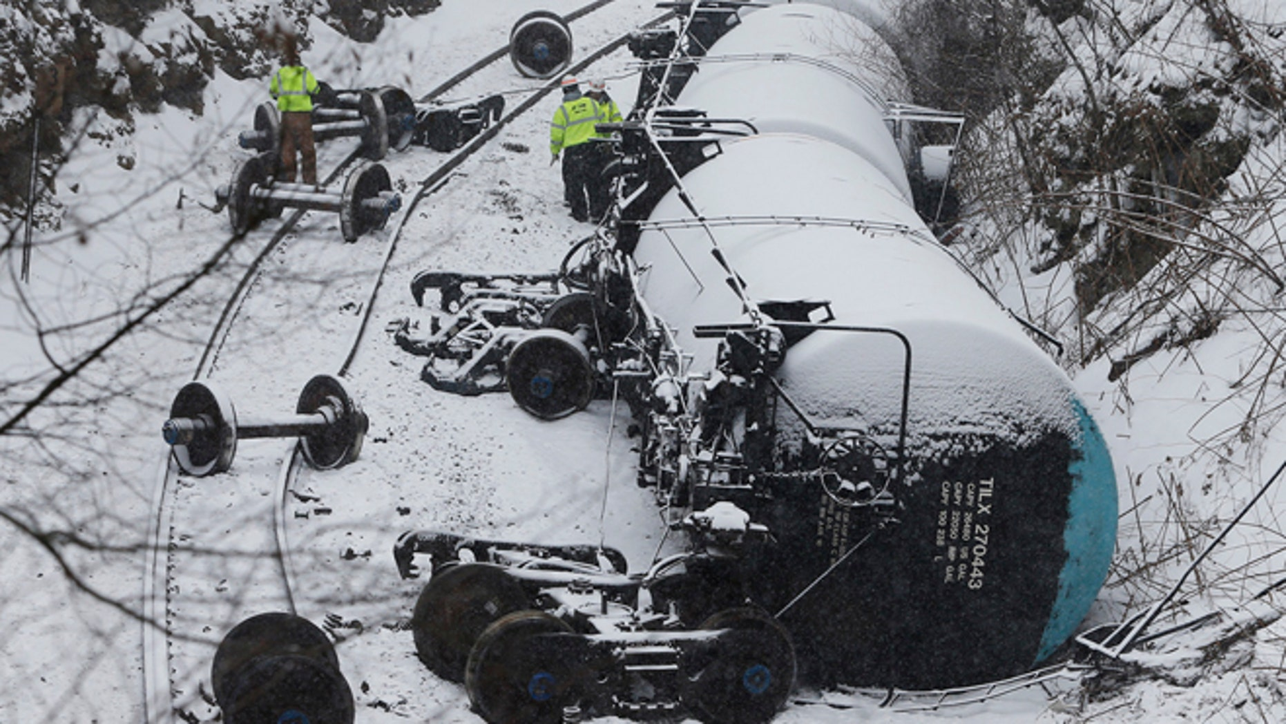 Feb. 13: Emergency personnel examine the wreckage of a train derailment near Vandergrift, Pennsylvania. A 120-car Norfolk Southern Corp train carrying heavy Canadian crude oil derailed and spilled in western Pennsylvania on Thursday, adding to a string of recent accidents that have prompted calls for stronger safety standards.