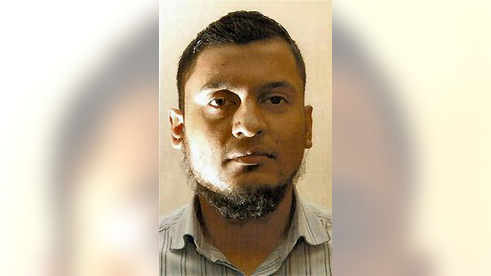 This undated photo released by the British Metropolitan Police shows Rajib Karim who was found guilty Monday Feb. 28, 2011 at Woolwich Crown Court in London of plotting to blow up a plane while working as a computer specialist with British Airways.