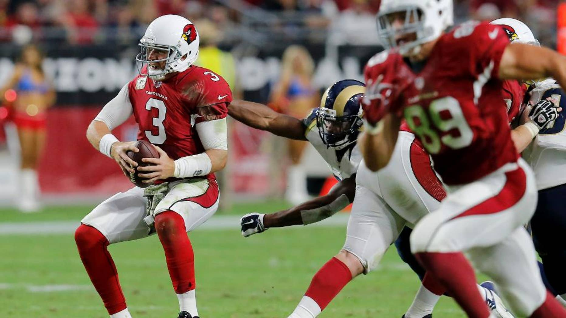 Arizona Cardinals quarterback Carson Palmer (3) falls after injuring his left knee during the second half of an NFL football game against the St. Louis Rams, Sunday, Nov. 9, 2014, in Glendale, Ariz. (AP Photo/Rick Scuteri)