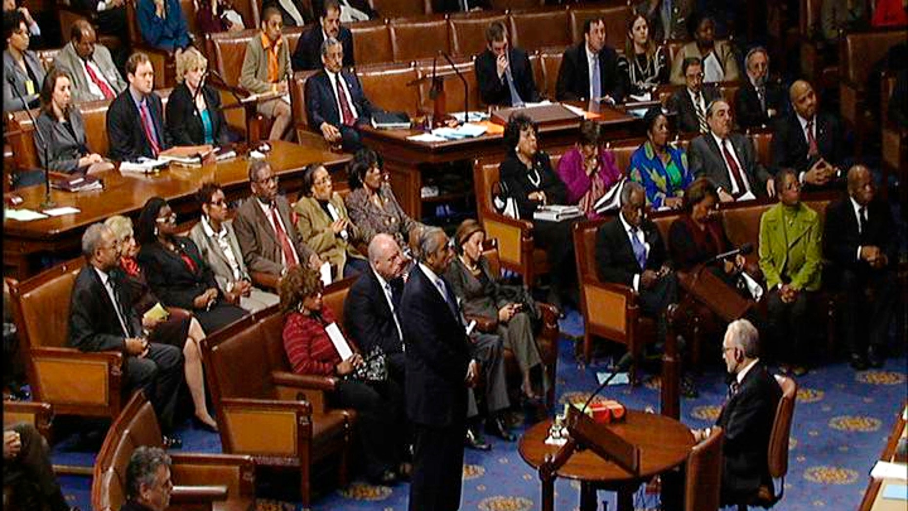This video frame grab image provided by House Television shows Rep. Charles Rangel, D-N.Y., stands in the well on the House floor while House Speaker Nancy Pelosi reads the censure resolution passed by the House on Capitol Hill in Washington, Thursday, Dec. 2, 2010.  (AP Photo/House Television)