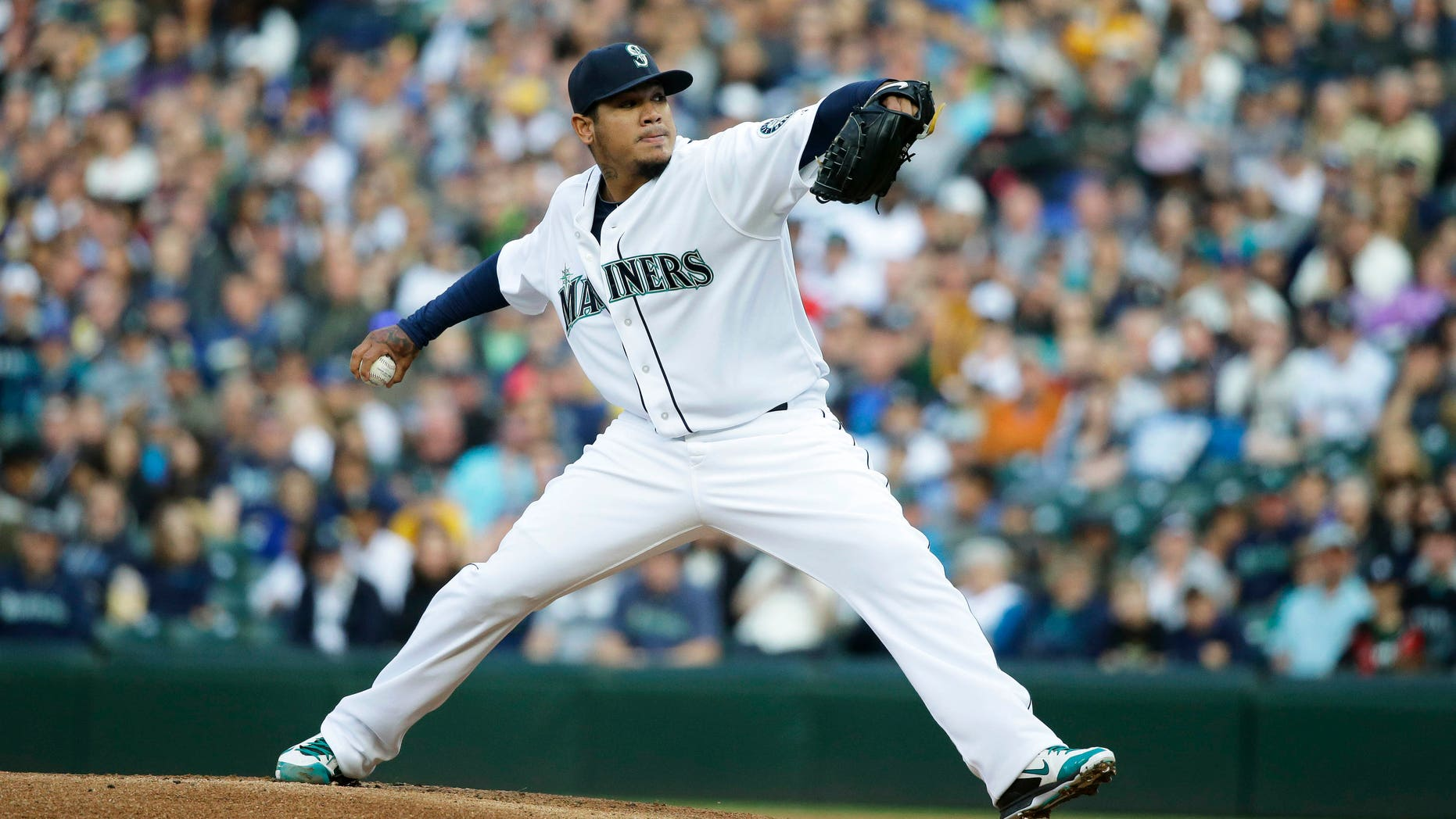 Seattle Mariners starting pitcher Felix Hernandez throws against the Texas Rangers in the first inning of a baseball game, Saturday, April 18, 2015, in Seattle. (AP Photo/Ted S. Warren)