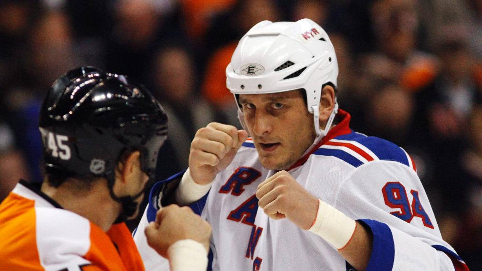 FILE - In this Nov. 4, 2010, file photo, Philadelphia Flyers' Jody Shelley, left, and New York Rangers' Derek Boogaard fight during an NHL hockey game in Philadelphia. A former minor league hockey player has been arrested on charges he sold illegally obtained prescription painkillers to former hockey player Derek Boogaard of the Rangers and the Minnesota Wild who died of an accidental overdose. Jordan Hart was arrested Tuesday, Sept. 9, 2014, on charges in a federal indictment unsealed in New York.  (AP Photo/Matt Slocum, File)