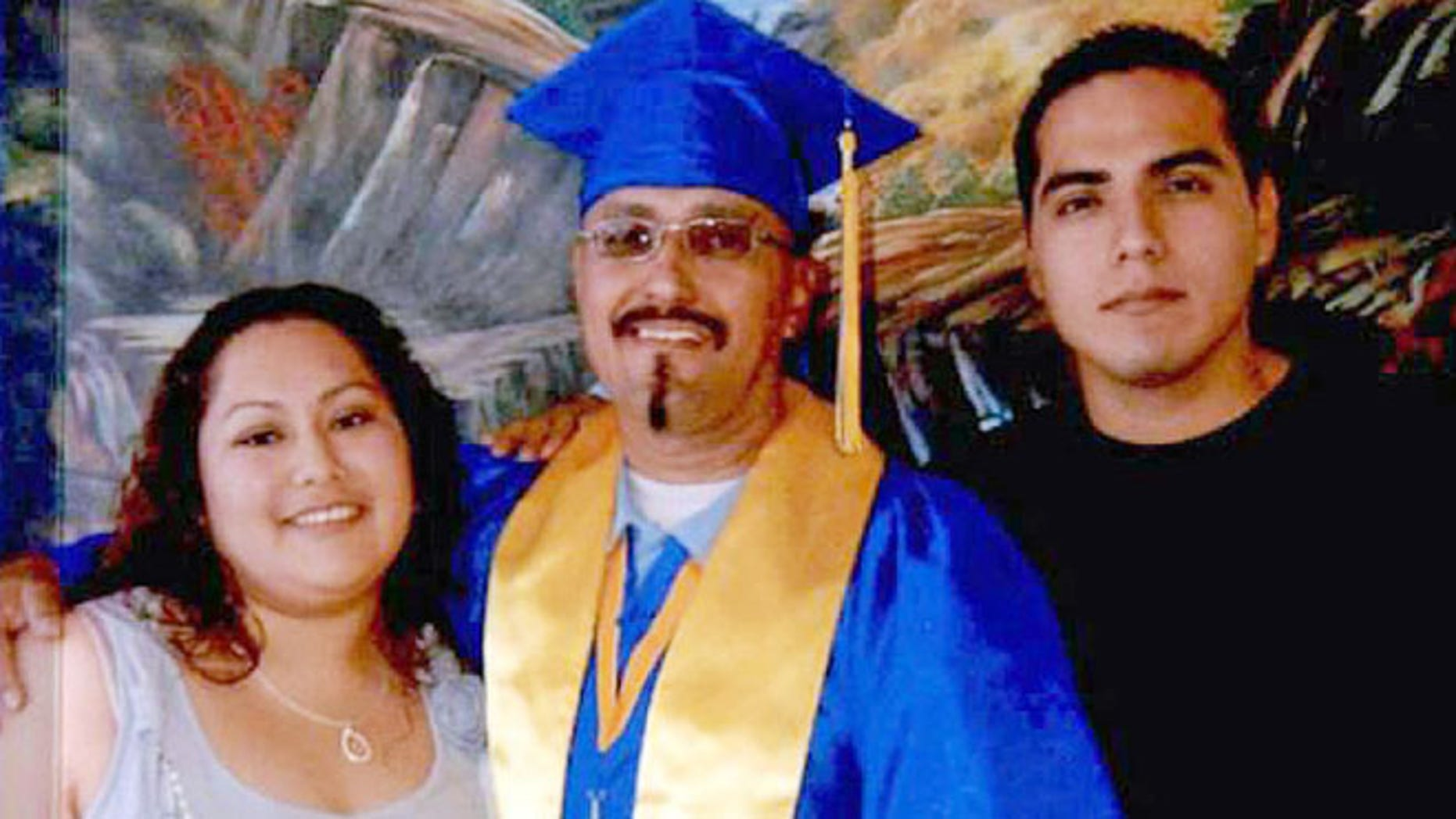 This December 2013 photo provided by the California Innocence Project shows Luis Vargas, center, with his daughter Crystal Vargas and son Daniel Vargas.