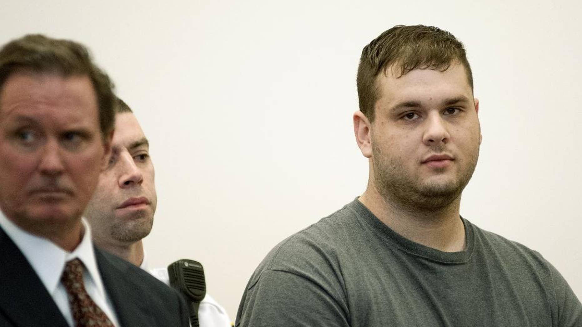Gregory Lewis, right, is arraigned in Worcester Superior Court in Worcester, Mass. Monday Nov.3, 2014. Attorney Michael Hussey and a court officer stand beside Lewis. Lewis is suspected of raping a 13-year-old girl, then going on a cross-country crime spree after cutting off his court-ordered monitoring device, He pleaded not guiltyduring his arraignment and was ordered held without bail. (AP Photo/Worcester Telegram & Gazette, Rick Cinclair, Pool)