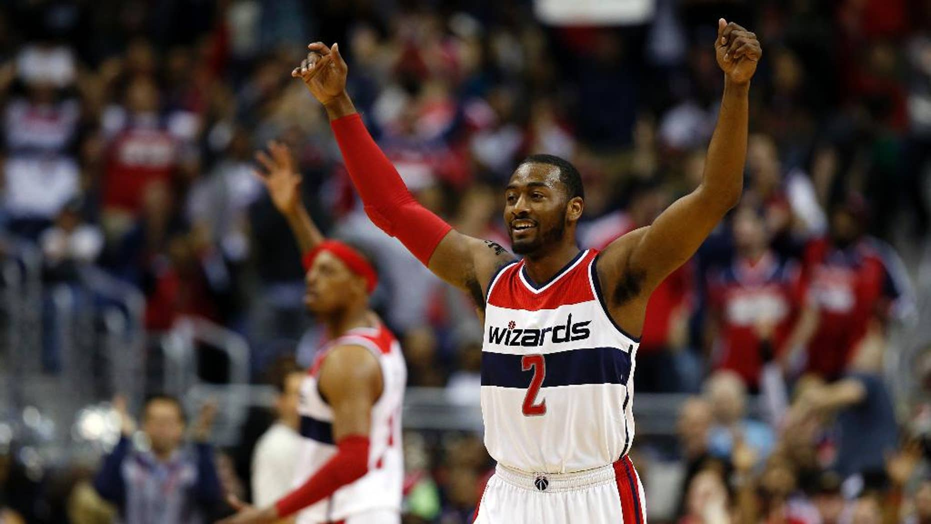 Washington Wizards guard John Wall (2) celebrates with forward Paul Pierce, behind, in the second half of Game 4 in the first round of the NBA basketball playoffs against the Toronto Raptors, Sunday, April 26, 2015, in Washington. The Wizards won 125-94 to complete the first sweep of a seven-game series in club history, and advancing them to the second-round. (AP Photo/Alex Brandon)