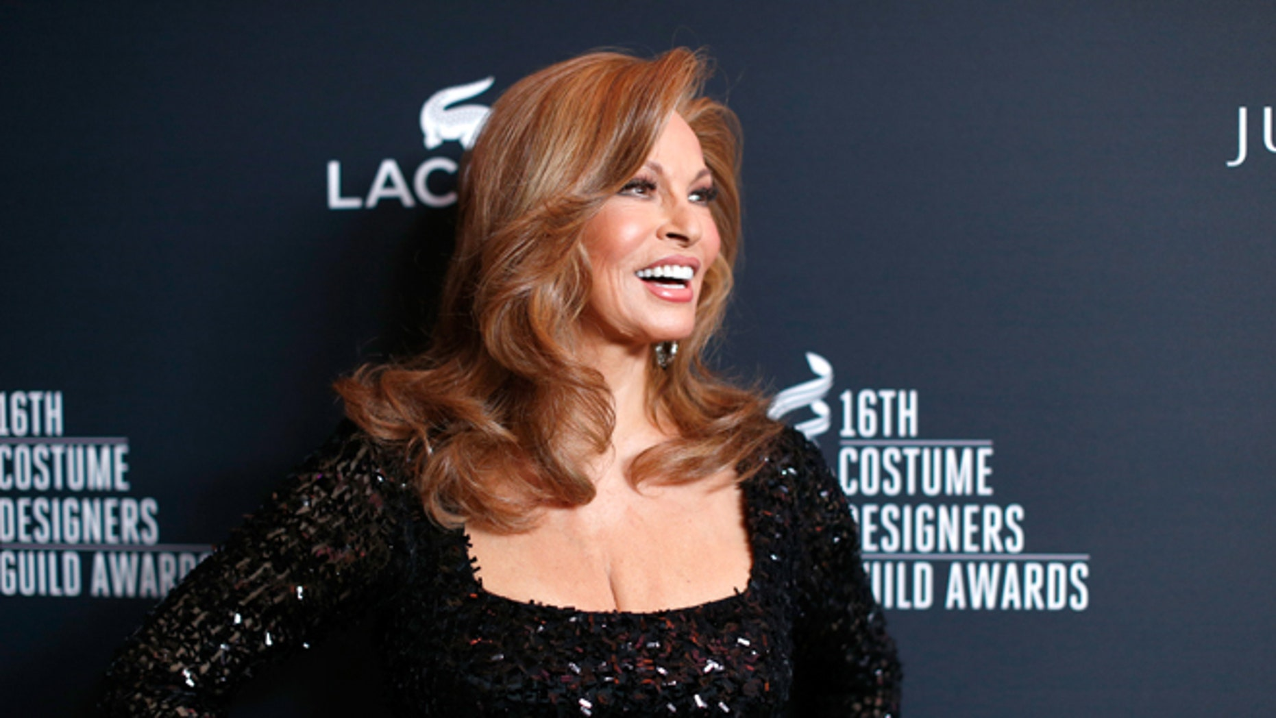Actress Raquel Welch attends the 16th Costume Designers Guild Awards with presenting sponsor Lacoste at The Beverly Hilton Hotel on February 22, 2014 in Beverly Hills, California.  (Photo by Christopher Polk/Getty Images for CDG)