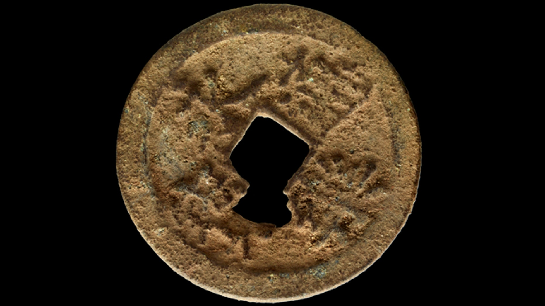 Feb. 8, 2013: A rare, 600-year-old Chinese coin that scientists from Illinois discovered on the Kenyan island of Manda. The museum announced the discovery Wednesday, March 13.
