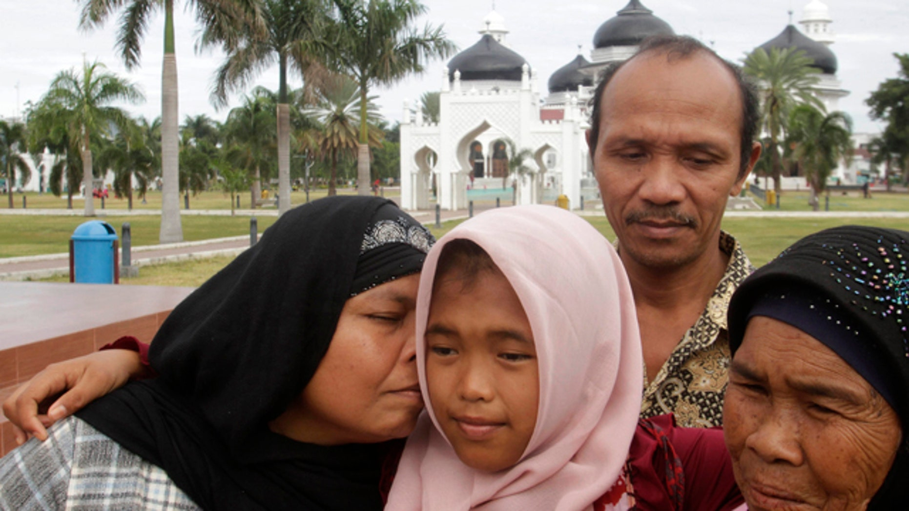 Raudhatul Jannah, was lost after being swept into the sea during the 2004 Indian Ocean tsunami. She was been found alive and living with a foster mother. She was reunited with her biological parents this week.   (REUTERS/Junaidi Hanafiah)