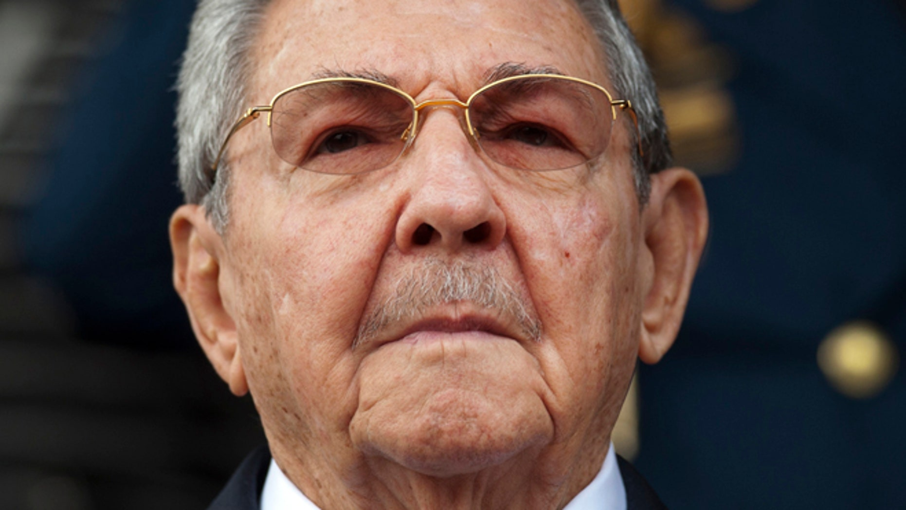 Cuba's President Raul Castro listens to the playing of national hymns during his welcome ceremony at Miraflores presidential palace before the start of an emergency ALBA meeting in Caracas, Venezuela, Tuesday, March 17, 2015. Leftist allies of Venezuela on Tuesday rallied behind embattled President Nicolas Maduro in his faceoff with the U.S. government, which he is accusing of trying to oust his socialist administration. (AP Photo/Ariana Cubillos)