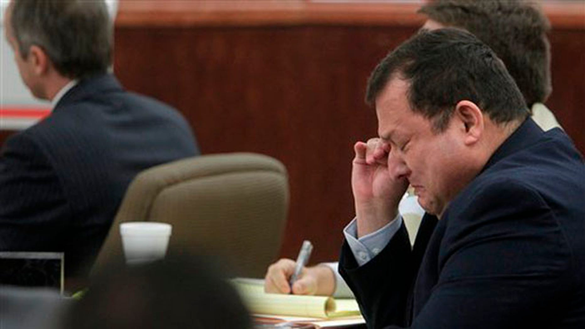 June 25, 2012: Raul Rodriguez weeps in the beginning of his trial at Harris County Criminal Courthouse in Houston.