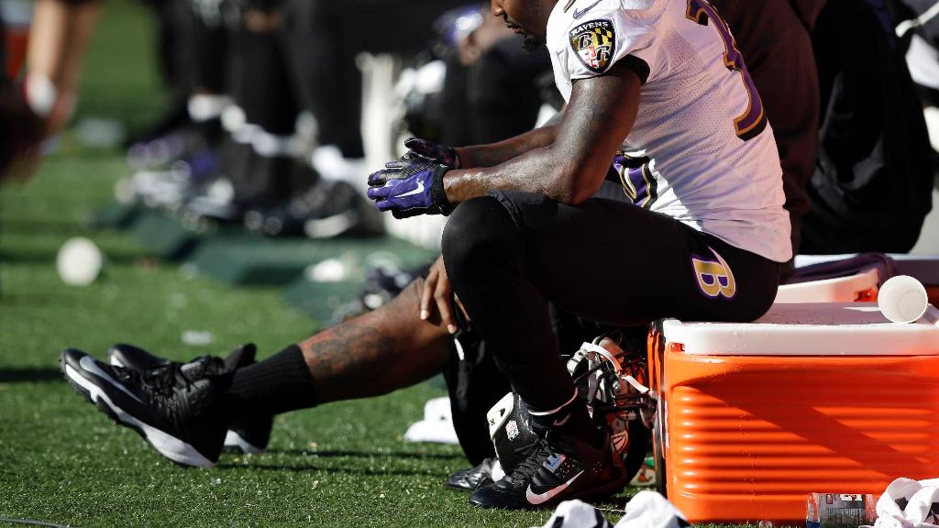 Baltimore Ravens strong safety Jeromy Miles sits on the bench in the final seconds of a 27-24 loss to the Cincinnati Bengals in an NFL football game in Cincinnati, Sunday, Oct. 26, 2014. (AP Photo/Darron Cummings)