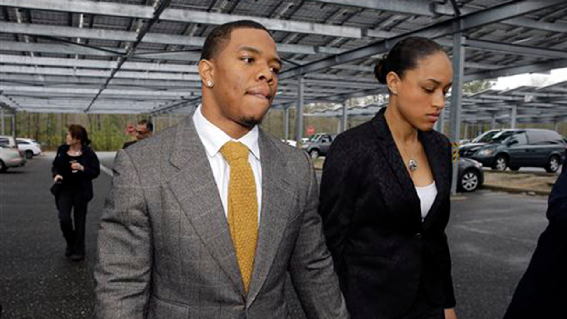 """FILE - In this May 1, 2014, file photo, Baltimore Ravens football player  Ray Rice holds hands with his wife, Janay Palmer, as they arrive at Atlantic County Criminal Courthouse in Mays Landing, N.J. Banter by two """"Fox & Friends"""" hosts about video showing Rice hitting his then future wife is under fire. The hosts, Brian Kilmeade and Steve Doocey, made their on-air comments Monday, Sept. 8, 2014, while discussing newly released elevator video showing Rice hitting Janay Palmer in February. (AP Photo/Mel Evans, File)"""