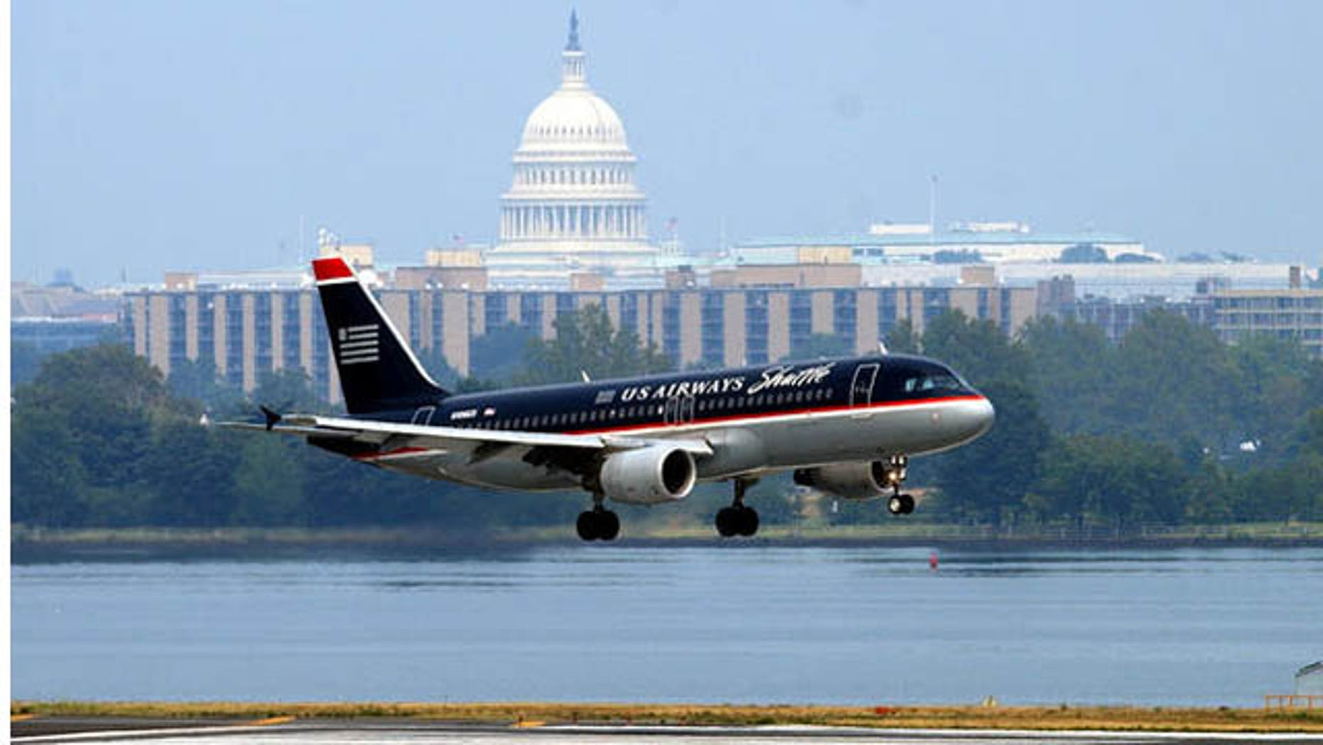This file photo shows a U.S. Airways plane landing at Reagan National Airport.