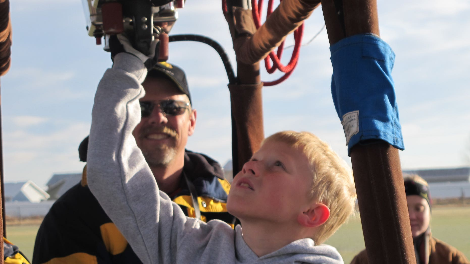 Nine-year-old Bobby Bradley is preparing for his first solo flight aboard an ultra-light balloon in June 2011.