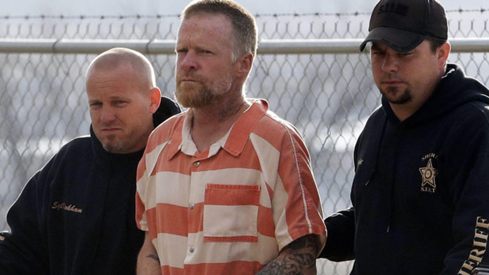 April 2: Sanpete Sheriff's Officers escort Troy James Knapp, 45, to the Sanpete County Jail Tuesday in Manti, Utah
