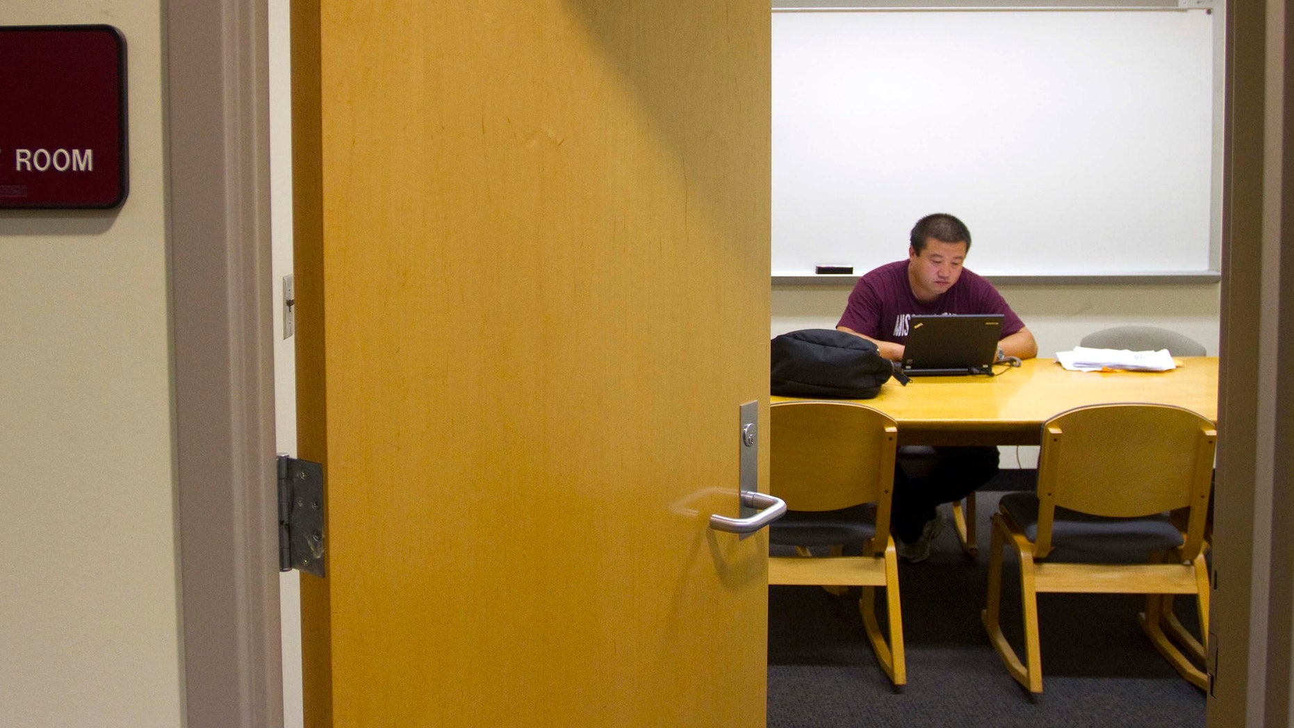 June 28, 2011: Wang Chengdong, a Chinese student in the Executive MBA program, works in a library study room at Missouri State University in Springfield, Mo.