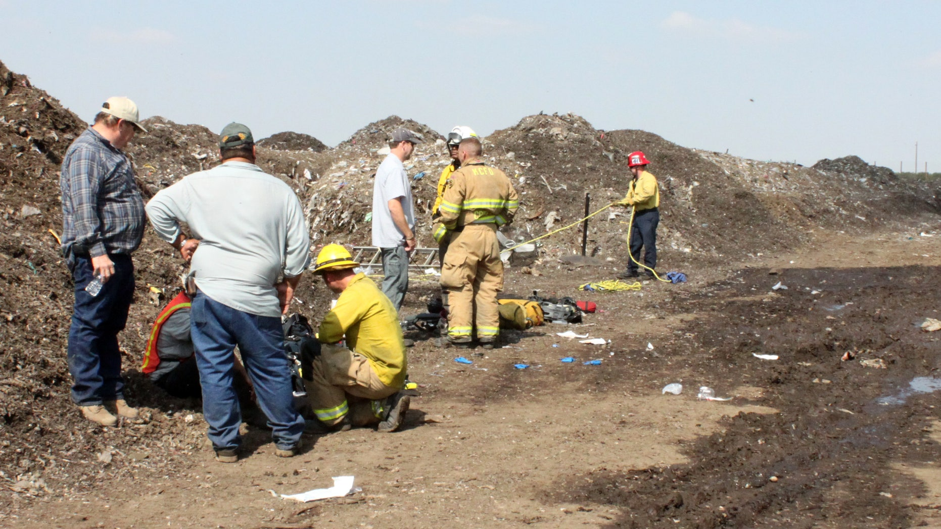 This image provided by the Kern County Sheriff's Department shows rescue personnel at the scene where a teenager was killed and his brother was critically injured in Lamont, Calif., when they were overcome by fumes in a tunnel at the recycling plant where they worked, Kern County officials said Friday Oct.14, 2011. (AP Photo/Kern County (Calif.) Sheriff's Department)