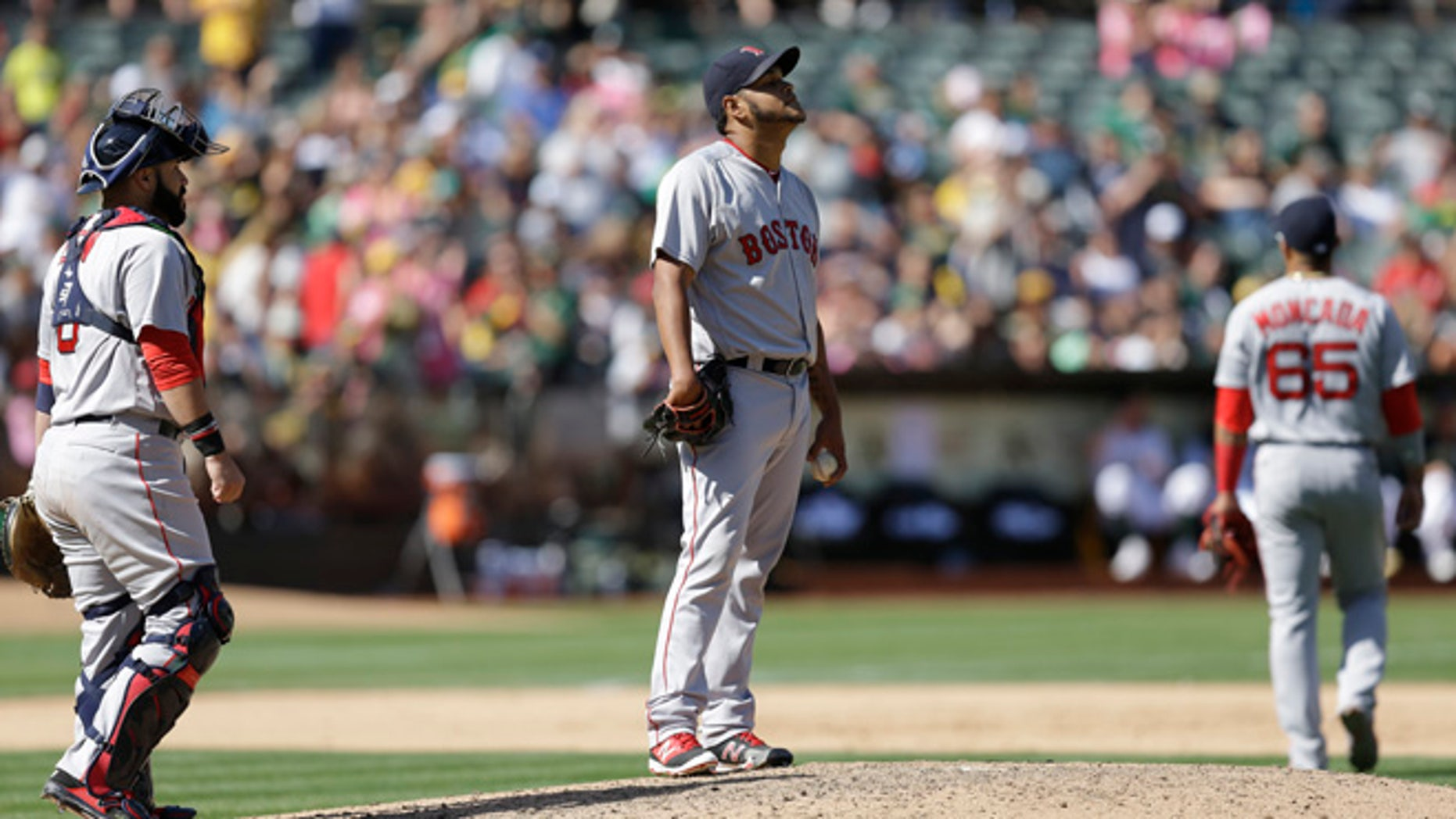 Boston Red Sox pitcher Eduardo Rodriguez, center, reacts after Oakland Athletics' Marcus Semien hit a single, breaking up a no hitter in the eighth inning of a baseball game, Sunday, Sept. 4, 2016, in Oakland, Calif. (AP Photo/Ben Margot)