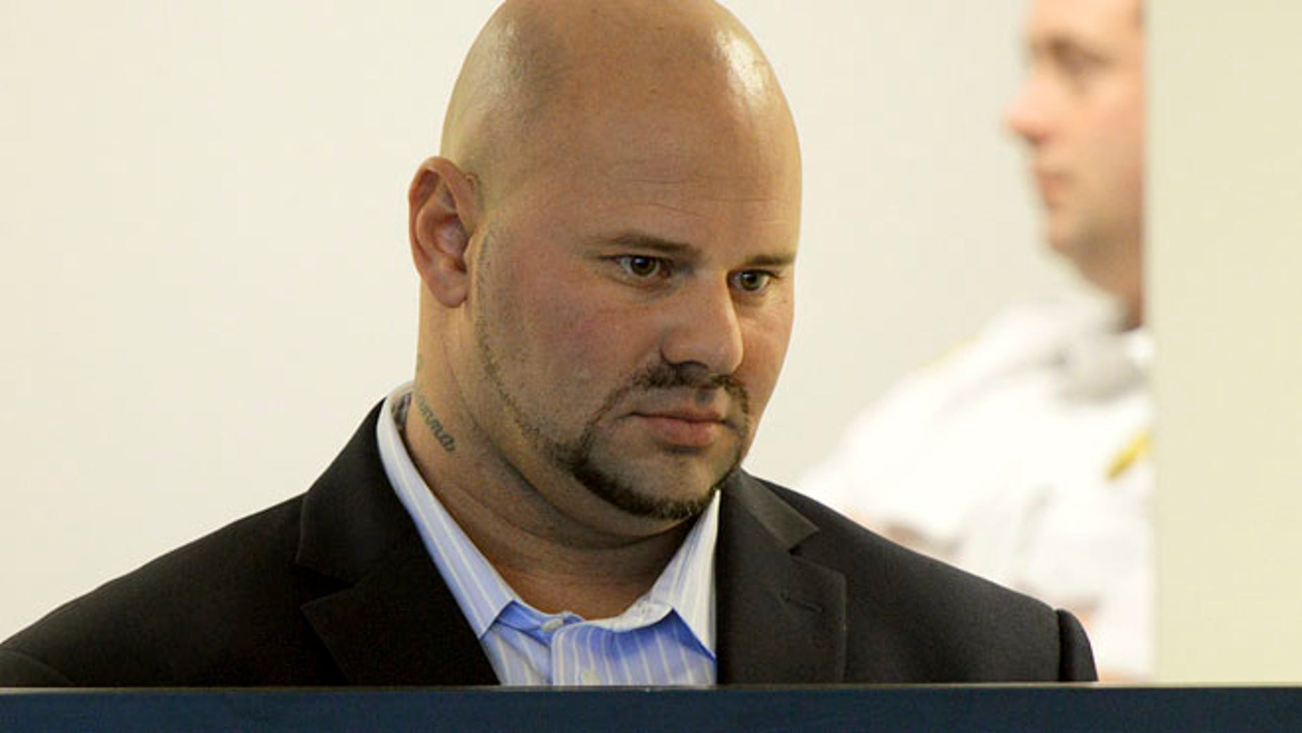 Oct. 8: Jared Remy, son of Boston Red Sox broadcaster Jerry Remy, stands during arraignment at Middlesex Superior Court in Woburn, Mass.