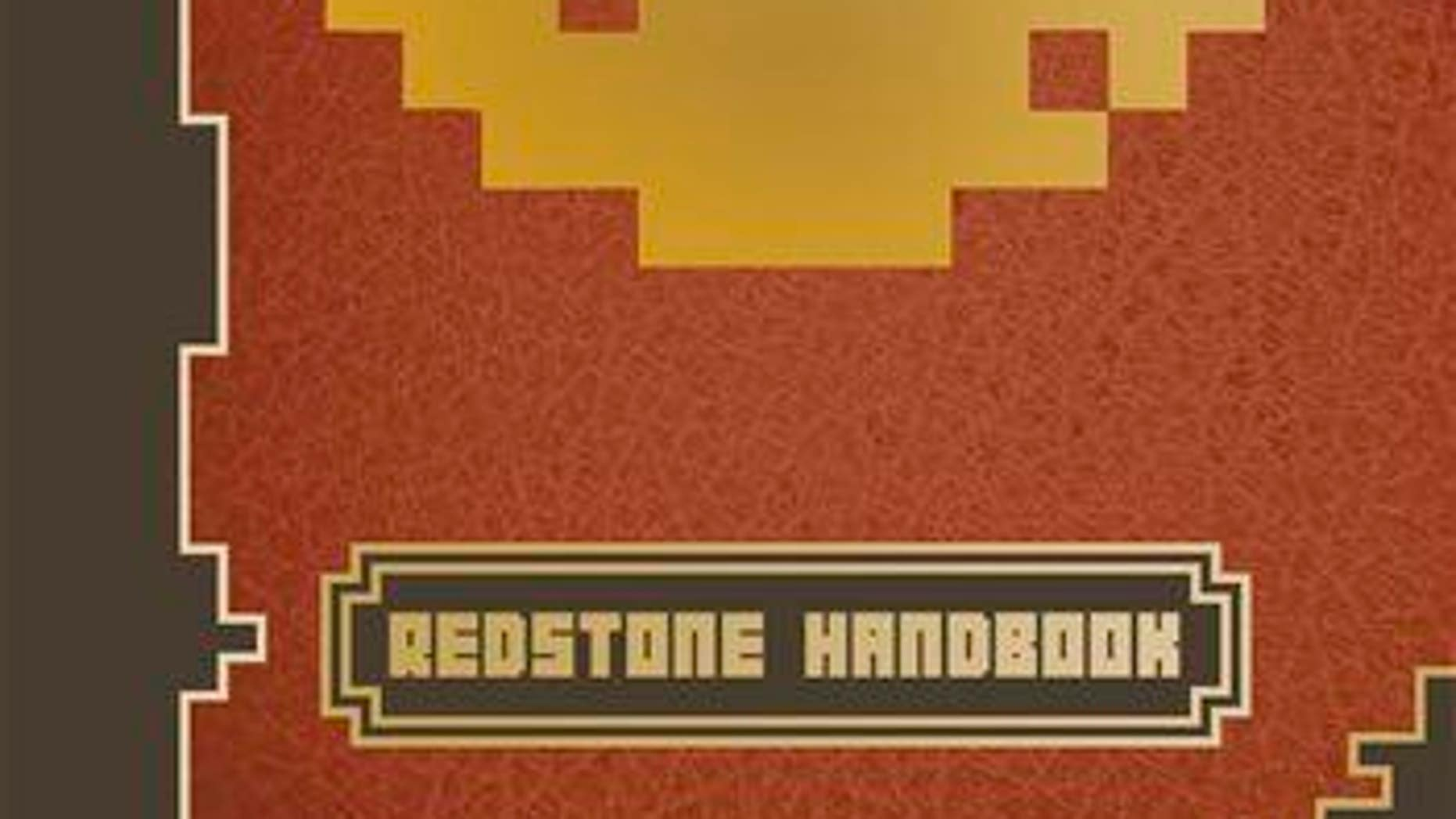 """This photo provided by Scholastic shows the cover of the book, """"Minecraft: Essential Handbook."""""""