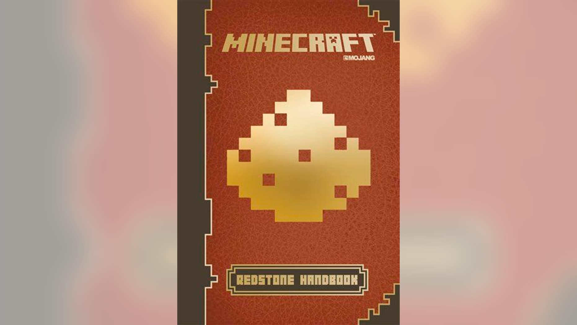 "This photo provided by Scholastic shows the cover of the book, ""Minecraft: Essential Handbook."""