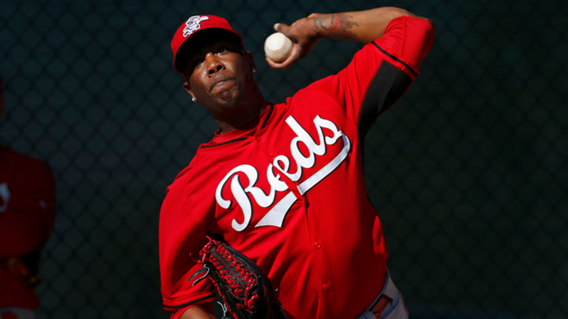 FILE - In this Feb. 15, 2014, file photo, Cincinnati Reds relief pitcher Aroldis Chapman throws during spring training baseball practice in Goodyear, Ariz. Chapman, with two black eyes, has returned to the Reds' clubhouse four days after being hit in the face by a line drive. The 26-year old left-hander had surgery at Banner Good Samaritan Medical Center, Thursday, March 20, 2014, to repair a broken bone above his left eye. (AP Photo/Paul Sancya, File)