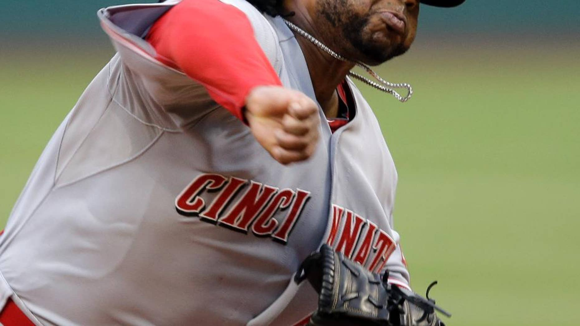 Cincinnati Reds starting pitcher Johnny Cueto delivers against the Cleveland Indians in the first inning of a baseball game Tuesday, Aug. 5, 2014, in Cleveland. (AP Photo/Mark Duncan)