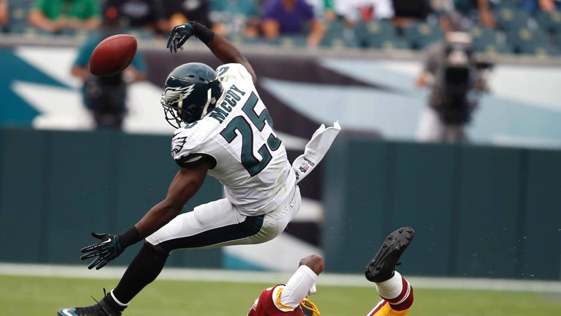 Philadelphia Eagles running back LeSean McCoy (25) fumbles the ball as Washington Redskins cornerback DeAngelo Hall (23) defends on the play during the second half of an NFL football game, Sunday, Sept. 21, 2014, in Philadelphia. (AP Photo/Michael Perez)