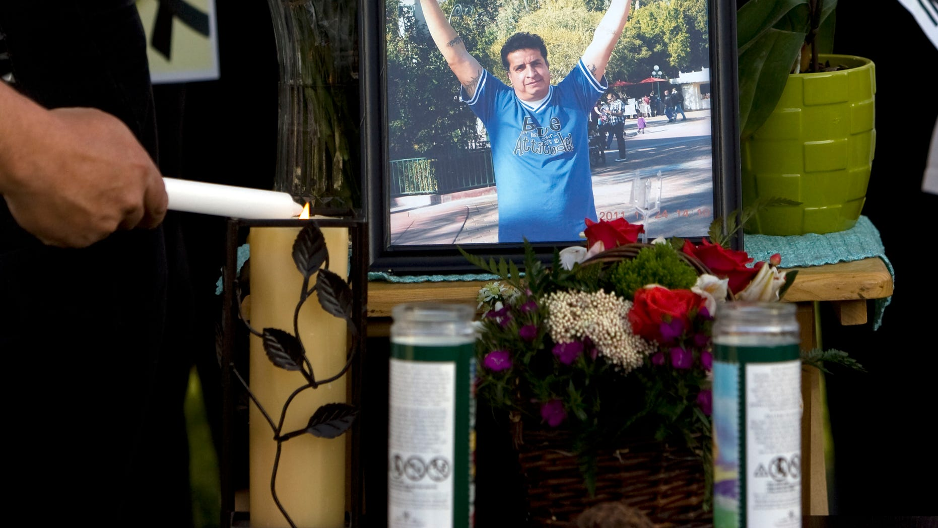 May 5, 2013: A mourner light candles at a makeshift memorial before a news conference by the family to discuss the death of Ricardo Portillo, who passed away after injuries he sustained after an assault by a soccer player at a soccer game he was refereeing on April 27, in Salt Lake City.