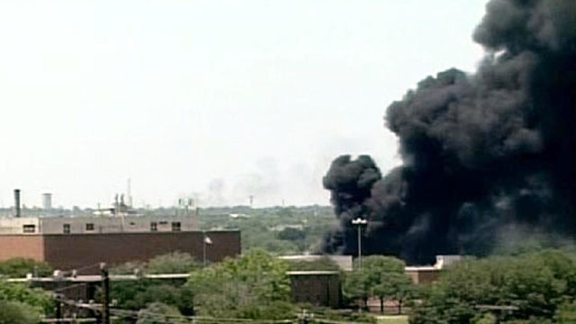 May 5: Plumes of smoke rise over San Antonio after truck exploded at the AGE refinery.