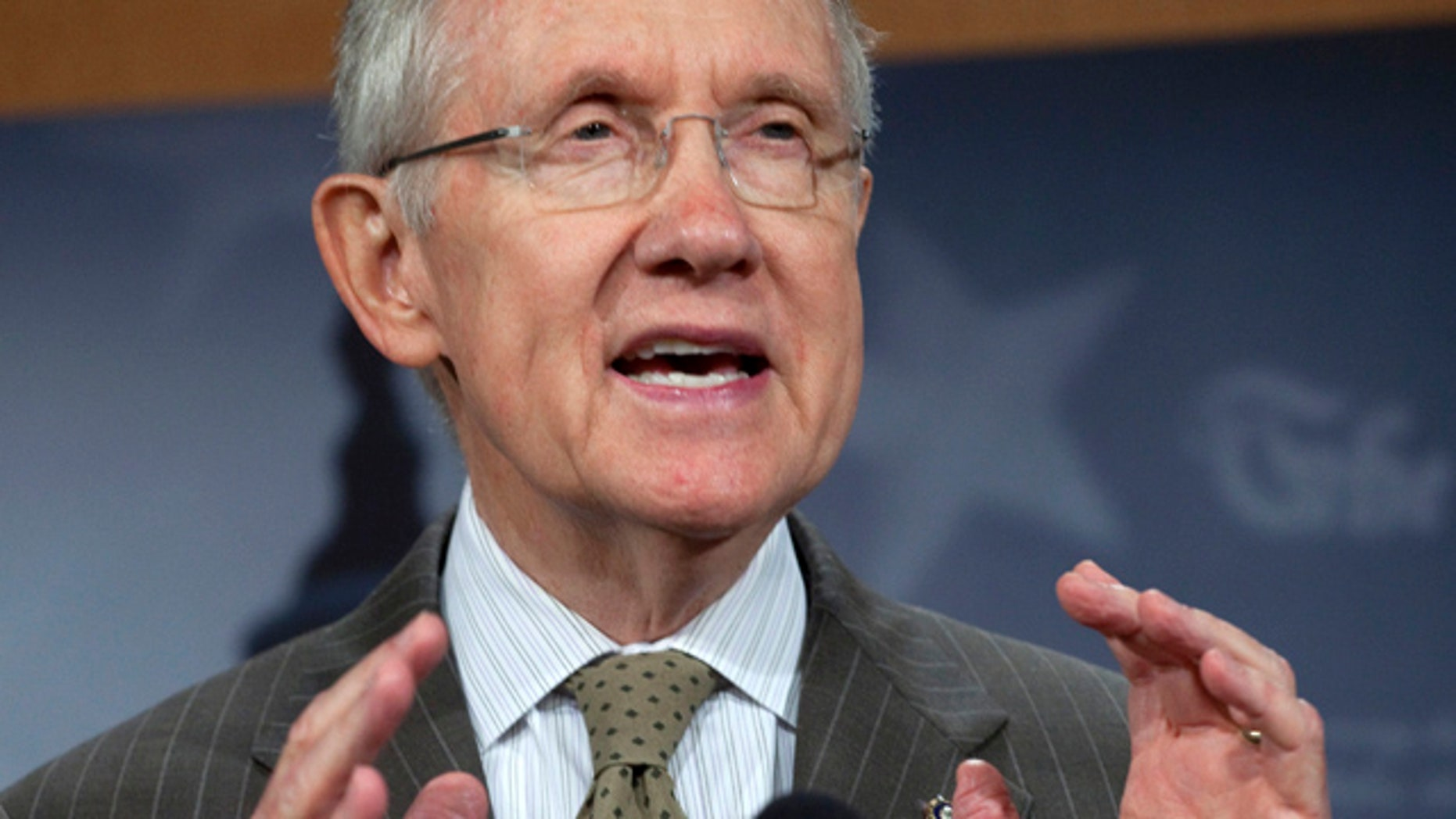 Sept. 22, 2011: Senate Majority Leader Harry Reid of Nevada gestures during a news conference on Capitol Hill.