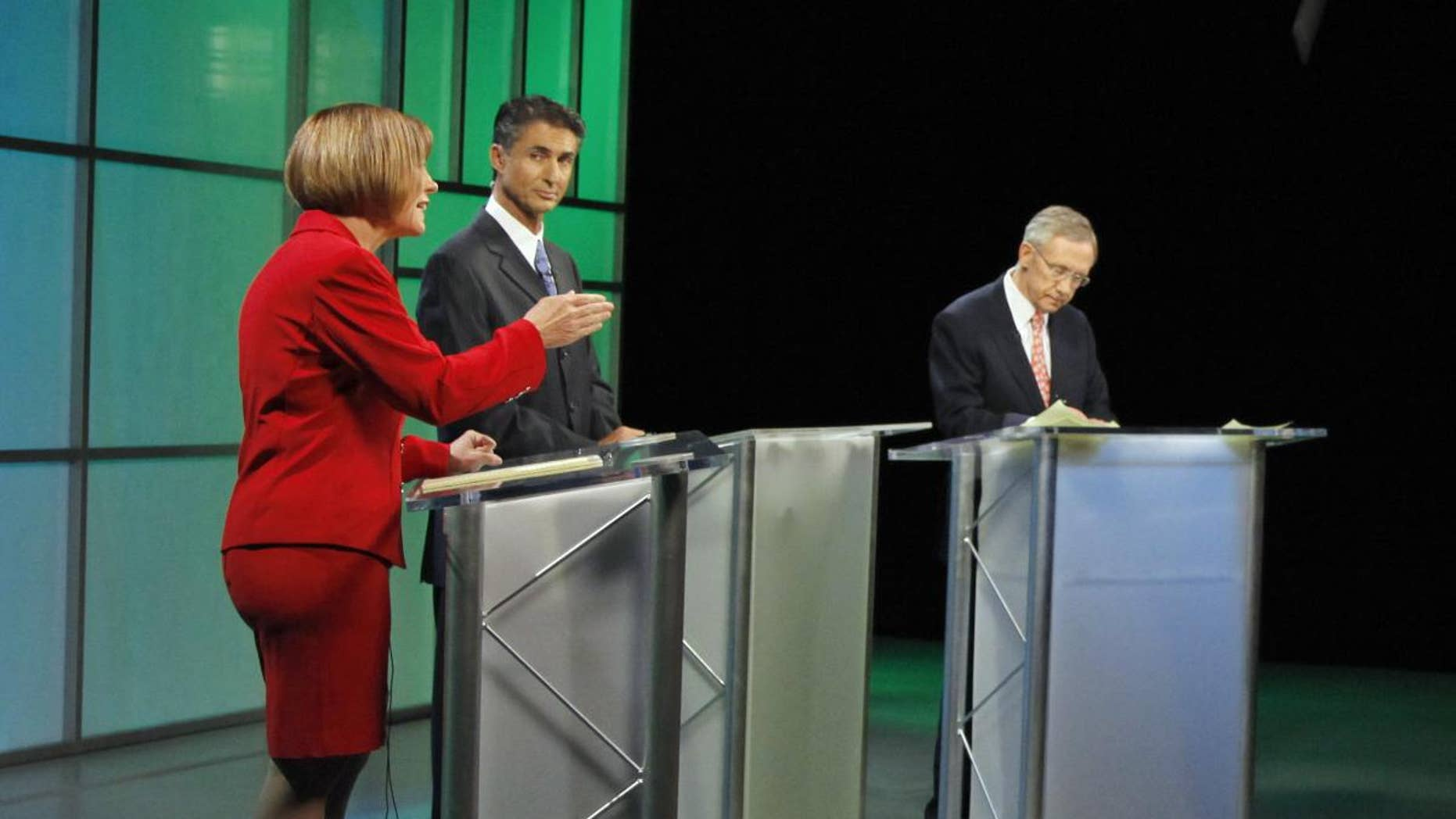 Republican Senate candidate Sharron Angle, left, speaks as moderator Mitch Fox, center, and Senate Majority Leader Harry Reid listen during a televised Nevada Senate debate Oct. 14, 2010, in Las Vegas. (AP Photo)