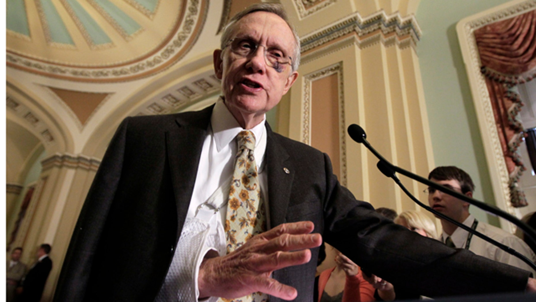 May 17: Senate Majority Leader Harry Reid, D-Nev., speaks to reporters as the Senate votes to continue tax breaks for oil companies, at the Capitol in Washington.