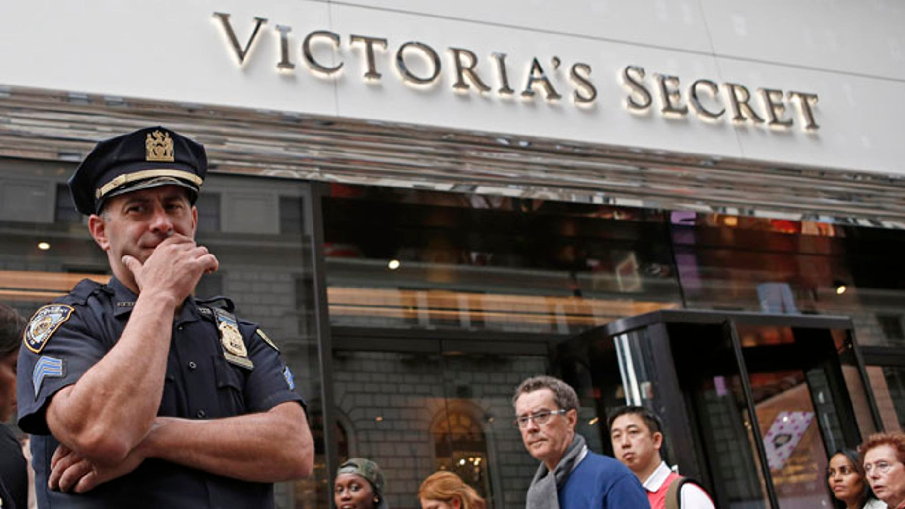 Oct. 17, 2013: A New York City police officer stands in front of the Victoria's Secret Herald Square store in midtown Manhattan in New York.