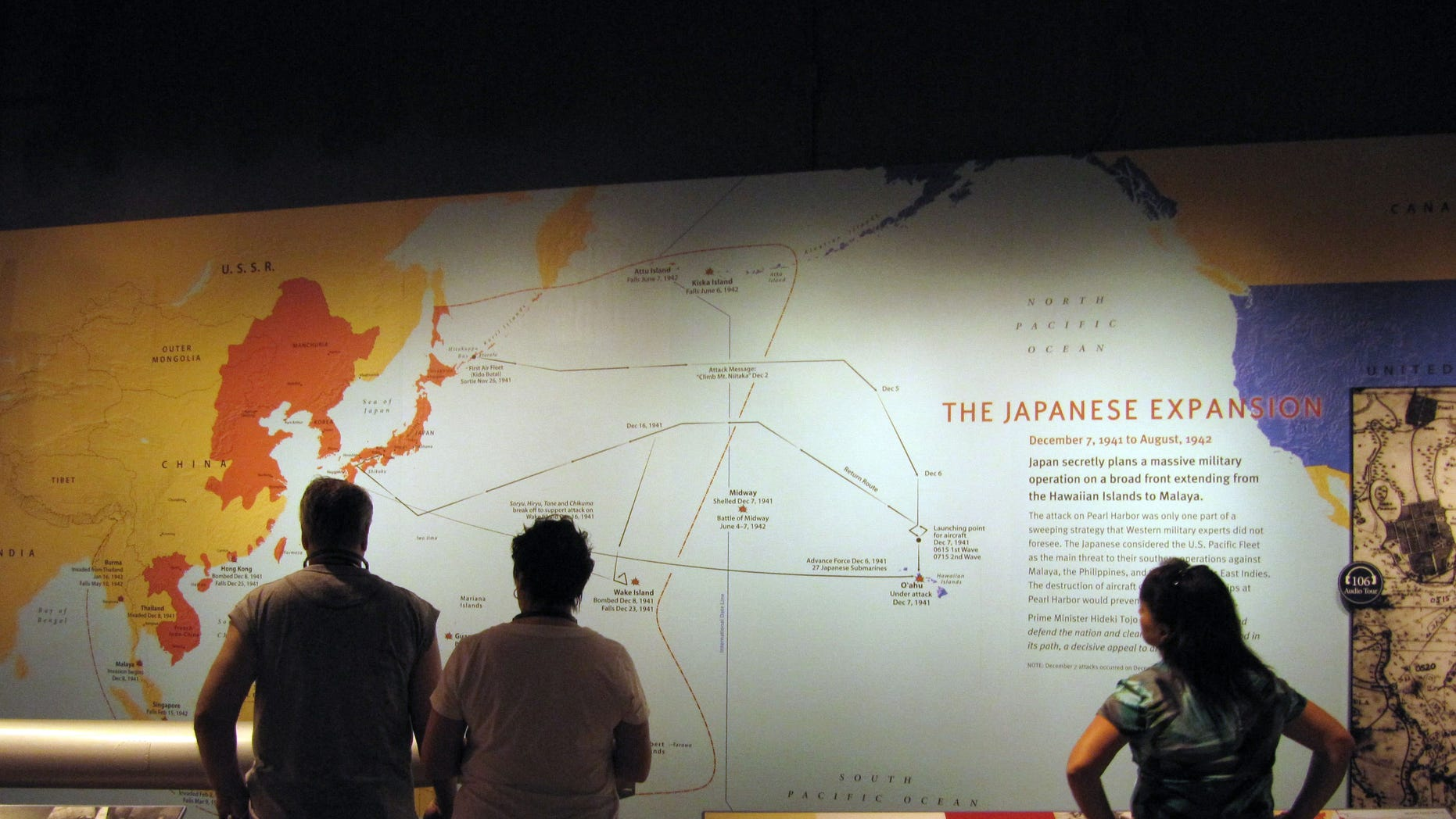 April 15, 2011: Visitors to the USS Arizona Memorial look at a display at Pearl Harbor, Hawaii. Visitors to Pearl Harbor are seeing snapshots of 1930s Japan as they stroll through the National Park Service's new museum about the Dec. 7, 1941 attack that dragged the U.S. into World War II.