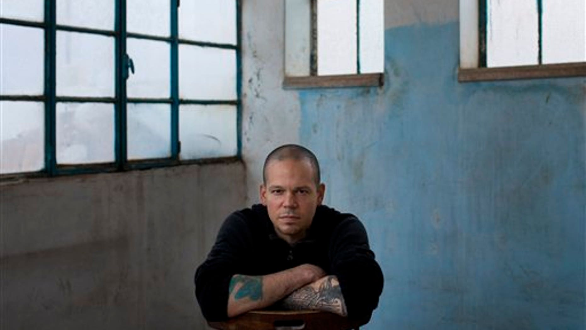 """Rene Perez Joglar, also known as Residente, of Puerto Rico's musical group Calle 13, poses for a portrait after an interview with The Associated Press in the West Bank town of Beit Shaour, near Bethlehem, Thursday, Dec. 5, 2013. Perez has been in the West Bank filming Calle 13's next video called """"Multi Viral."""" (AP Photo/Bernat Armangue)"""