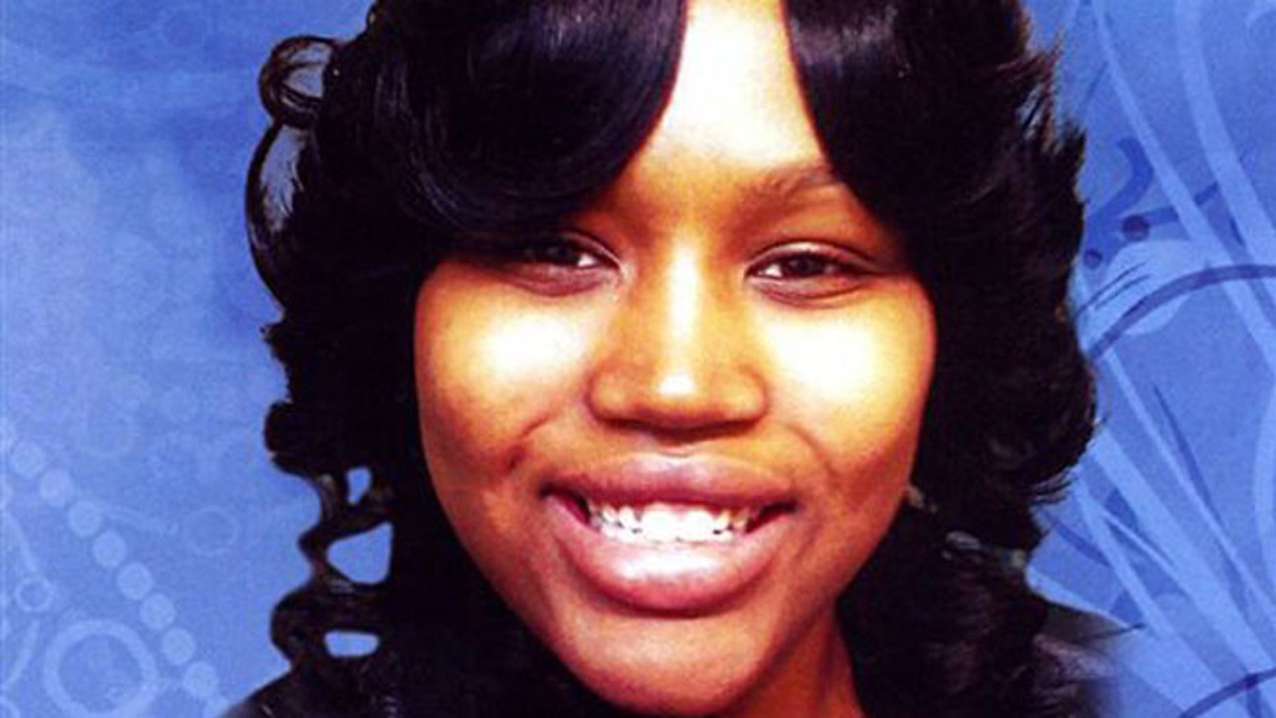 This undated file photo is the cover of a funeral program showing 19-year-old Renisha McBride from a service in Detroit.