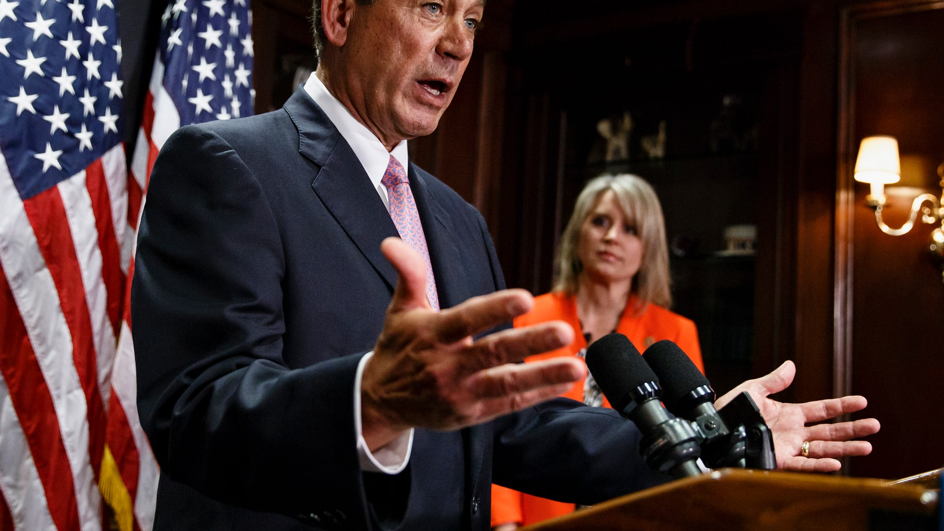 April 29, 2014: House Speaker John Boehner of Ohio, joined by Rep. Renee Ellmers, R-N.C., talks to reporters following a Republican strategy meeting on Capitol Hill in Washington.