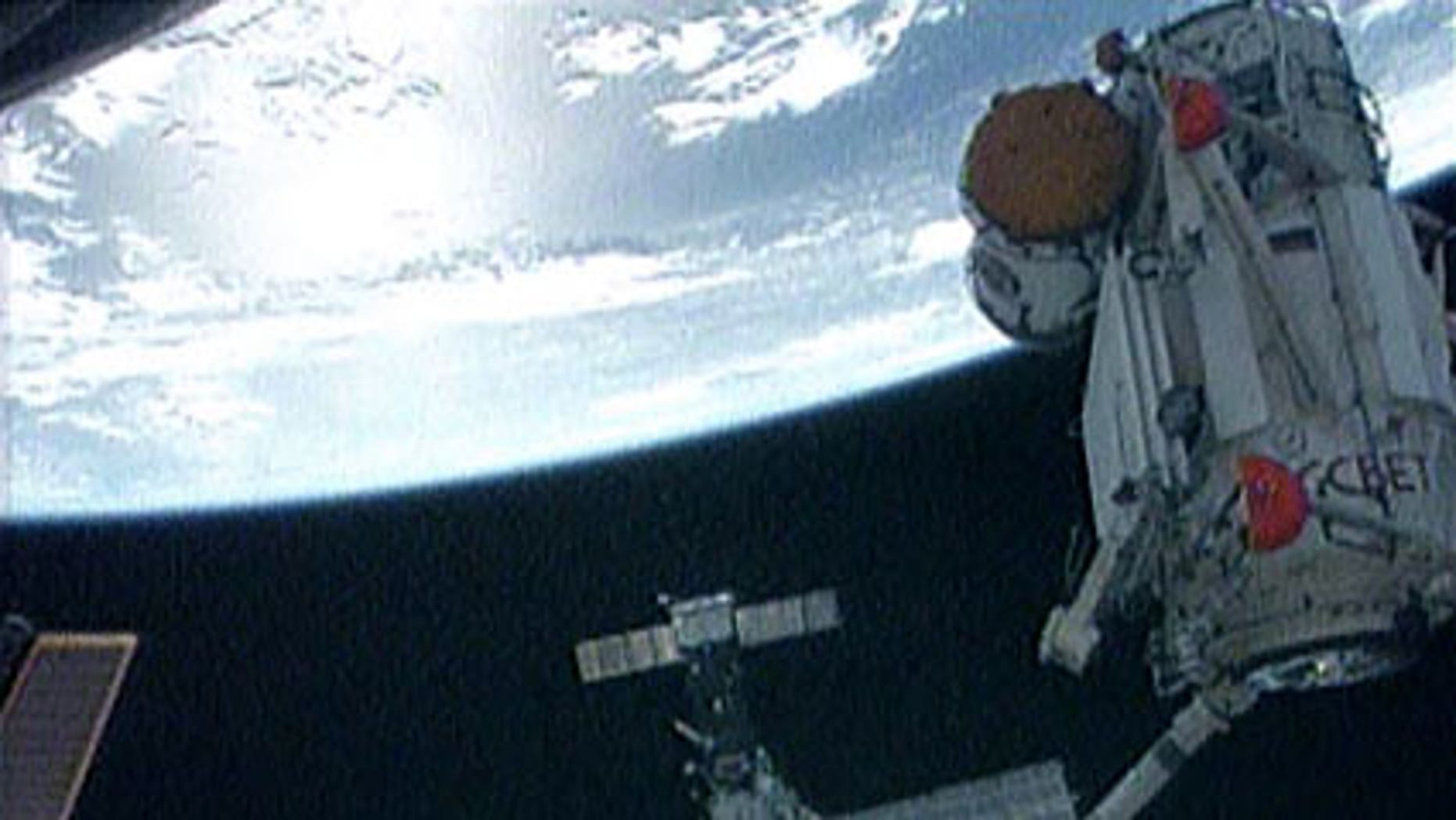 May 18: The International Space Station's robotic arm moves the Russian Mini-Research Module-1, named Rassvet, to its new position on the Russian segment of the station.