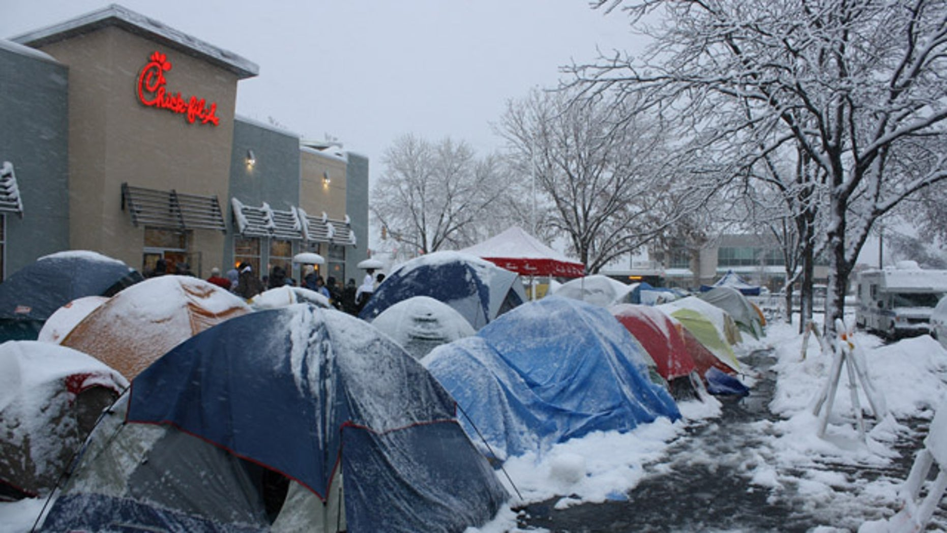 In this 2009 photo provided by Chick-fil-A, fans camp out in some extreme conditions, in Fort Collins, Colo., for the First 100 customers bonus coupons. Call it fanaticism or simply dedication, but these are the type of ultra-enthusiastic fans that every restaurant craves.   (AP Photo/Chick-fil-A)