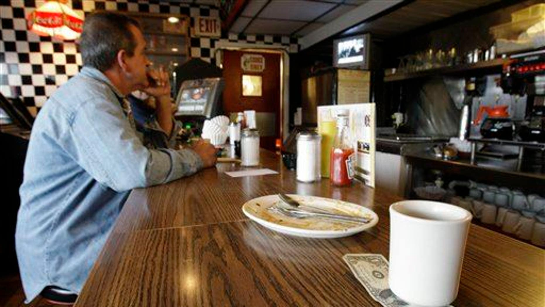 In this June 19, 2008 file photo, a tip is left by a customer at a restaurant in St. Clair Shores, Mich.