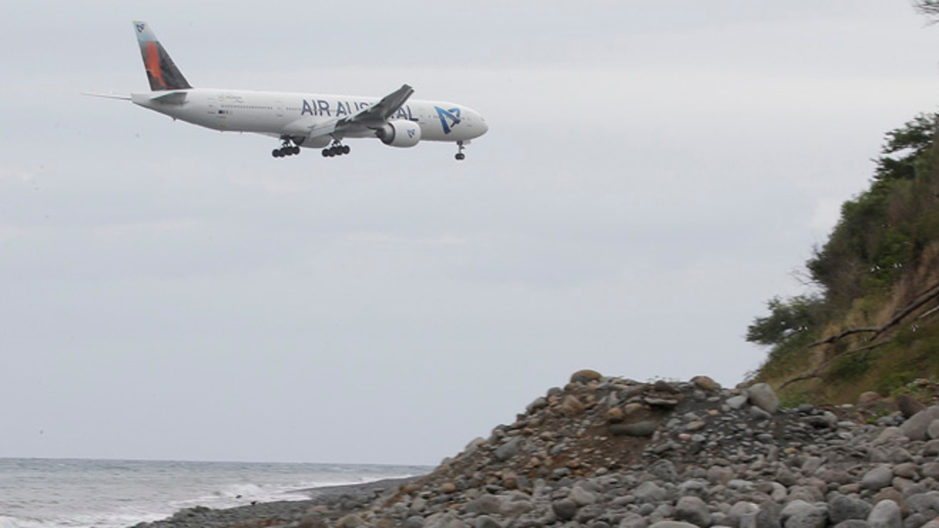 Aug. 3: An airplane flies over the Jamaique beach in Saint-Denis on the French Indian Ocean island of La Reunion.