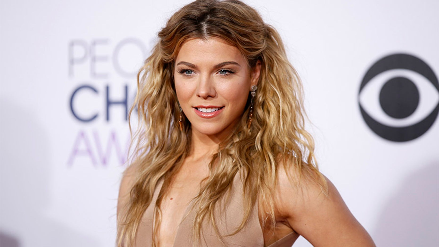 Kimberly Perry, from The Band Perry, arrives at the 2015 People's Choice Awards in Los Angeles.