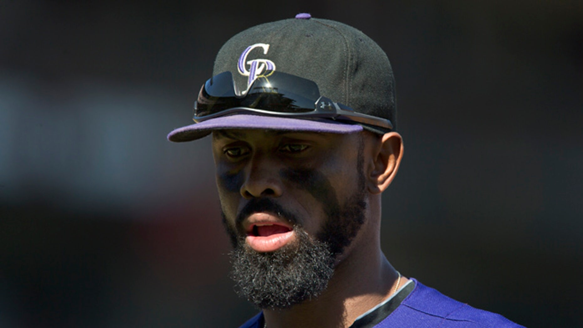 Shortstop Jose Reyes #7 of the Colorado Rockies heads to the dugout trailing 0-3 after the seventh inning against the San Francisco Giants at AT&T Park on October 4, 2015 in San Francisco, California, during the final day of the regular season.  (Photo by Brian Bahr/Getty Images)