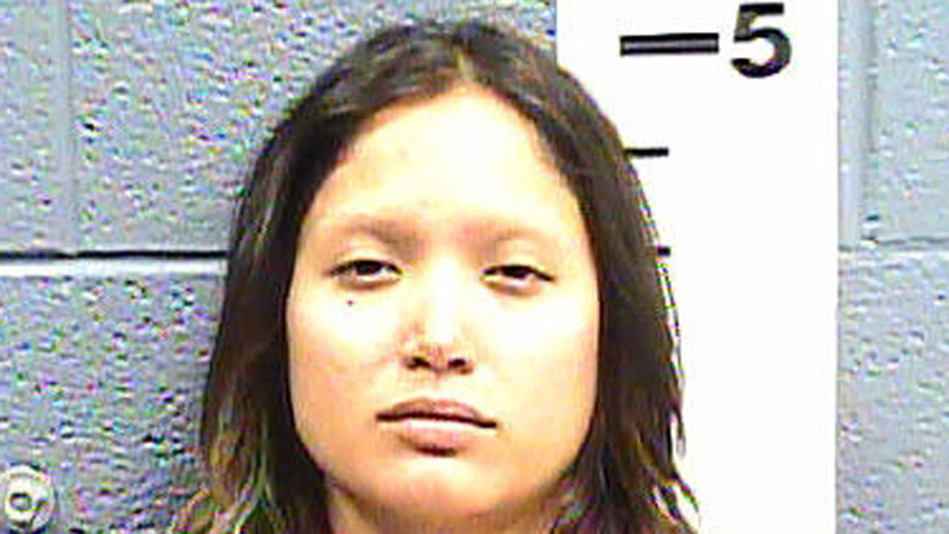 Aurelia Reyes was arrested after grabbing her boyfriend's head and allegedly biting off his lower lip.