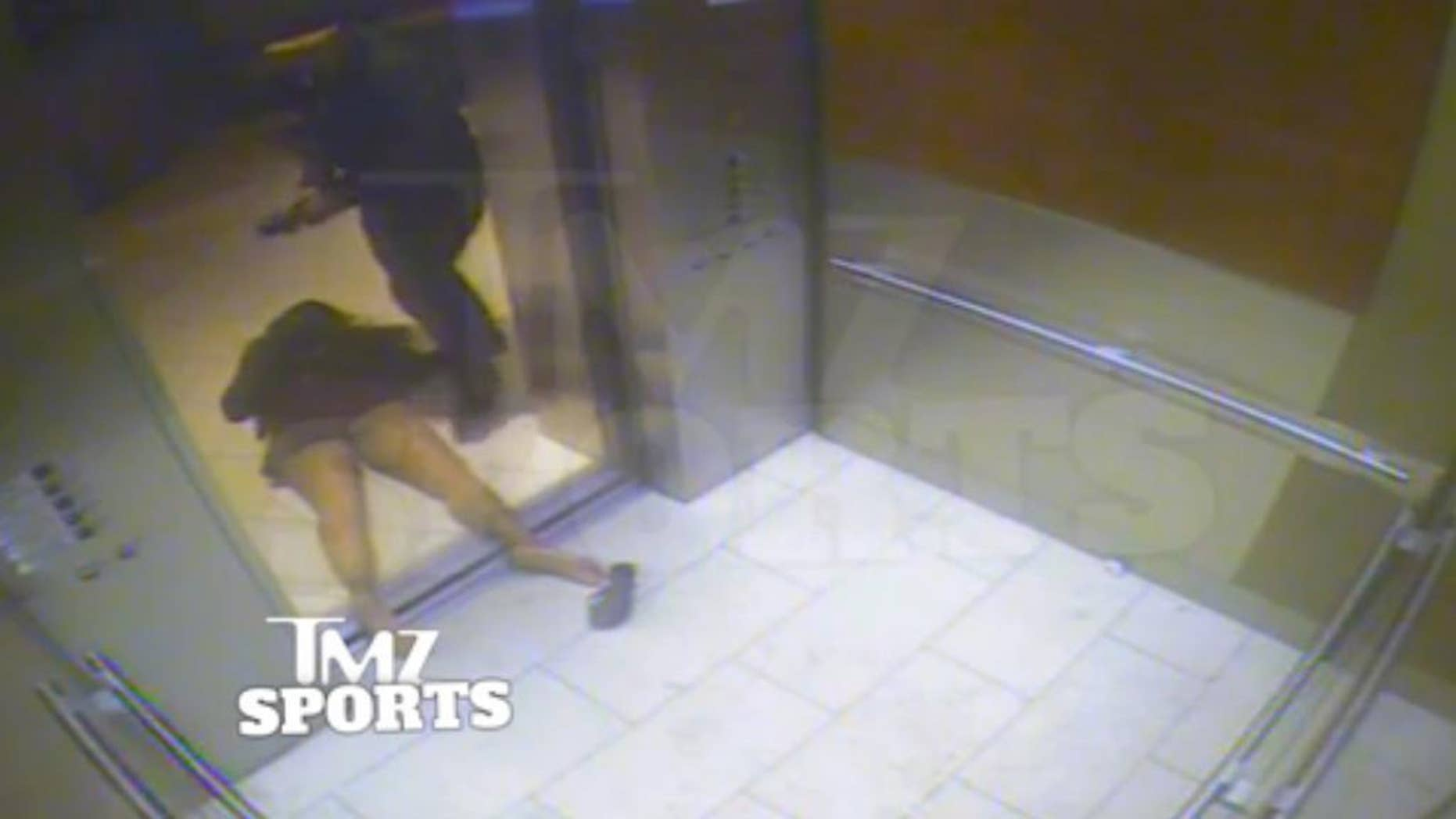 """FILE - In this February 2014 file photo, from a still image taken from a hotel security video released by TMZ Sports, Baltimore Ravens running back Ray Rice drags his fiancee, Janay Palmer, out of an elevator moments after knocking her off her feet, against the elevator's railing at the Revel casino in Atlantic City, N.J. A law enforcement official says he sent a video of Ray Rice punching his then-fiancee to an NFL executive five months ago, while league officers have insisted they didn't see the violent images until this week. The person played The Associated Press a 12-second voicemail from an NFL office number on April 9 confirming the video arrived. A female voice expresses thanks and says: """"You're right. It's terrible."""" (AP Photo/File)"""