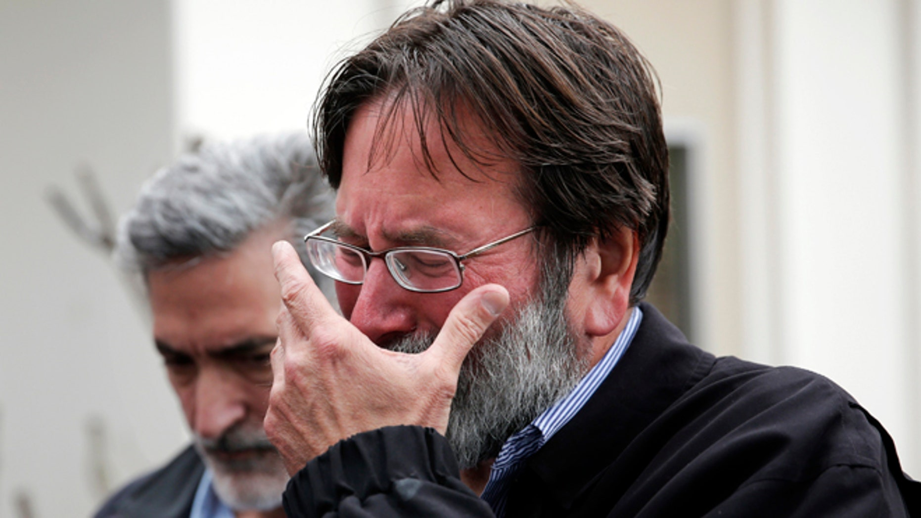 May 24, 2014: Richard Martinez who says his son Christopher Michael-Martinez was killed in Friday night's mass shooting that took place in Isla Vista, Calif., breaks down as he talks to media outside the Santa Barbara County Sheriff's Headquarters in Santa Barbara, Calif.