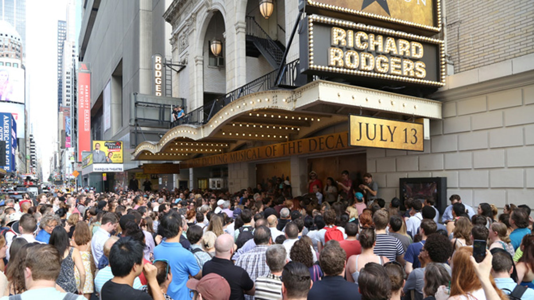 NEW YORK, NY - JULY 13:  Huge crowds line up for the Lottery to win $10 front-row seats to see the new Broadway musical Hamilton. The musical about Founding Father Alexander Hamilton, whose face is depicted on the $10 bill, had their first preview at the Richard Rodgers Theatre on July 13, 2015 in New York City.  (Photo by Walter McBride/Getty Images)